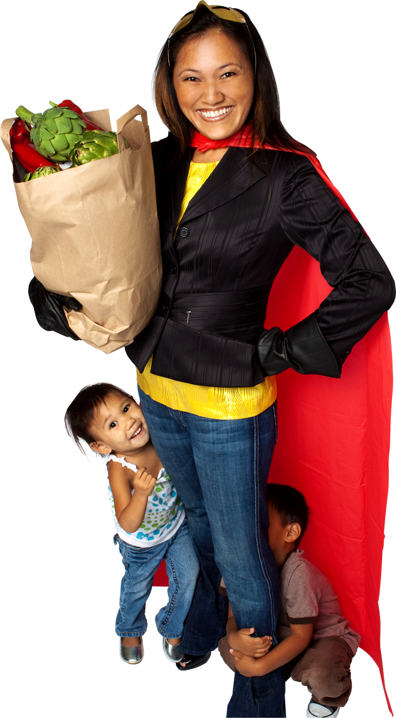 Woman wearing superhero cape holding bag a groceries with a child holding on to her leg